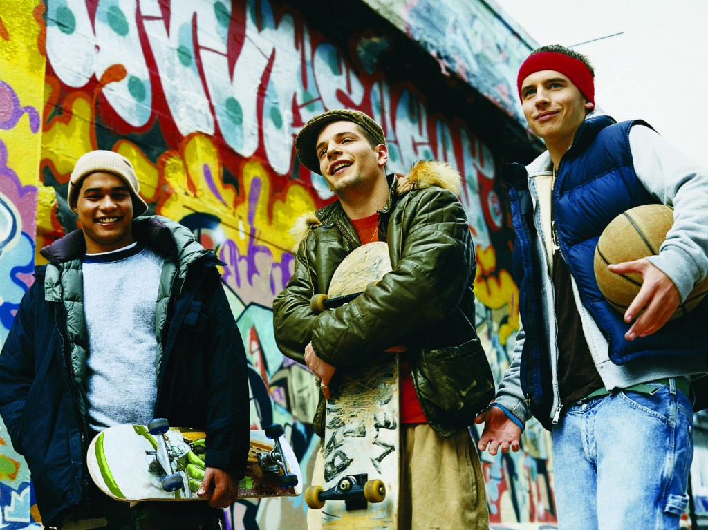 Teenage Boys Standing in an Urban Backstreet Holding Skateboards and a Basketball